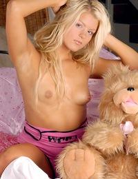 A blonde horny teenage beauty rubs her slippery coochie