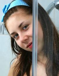 Adorable teen girl masturbates with a toothbrush